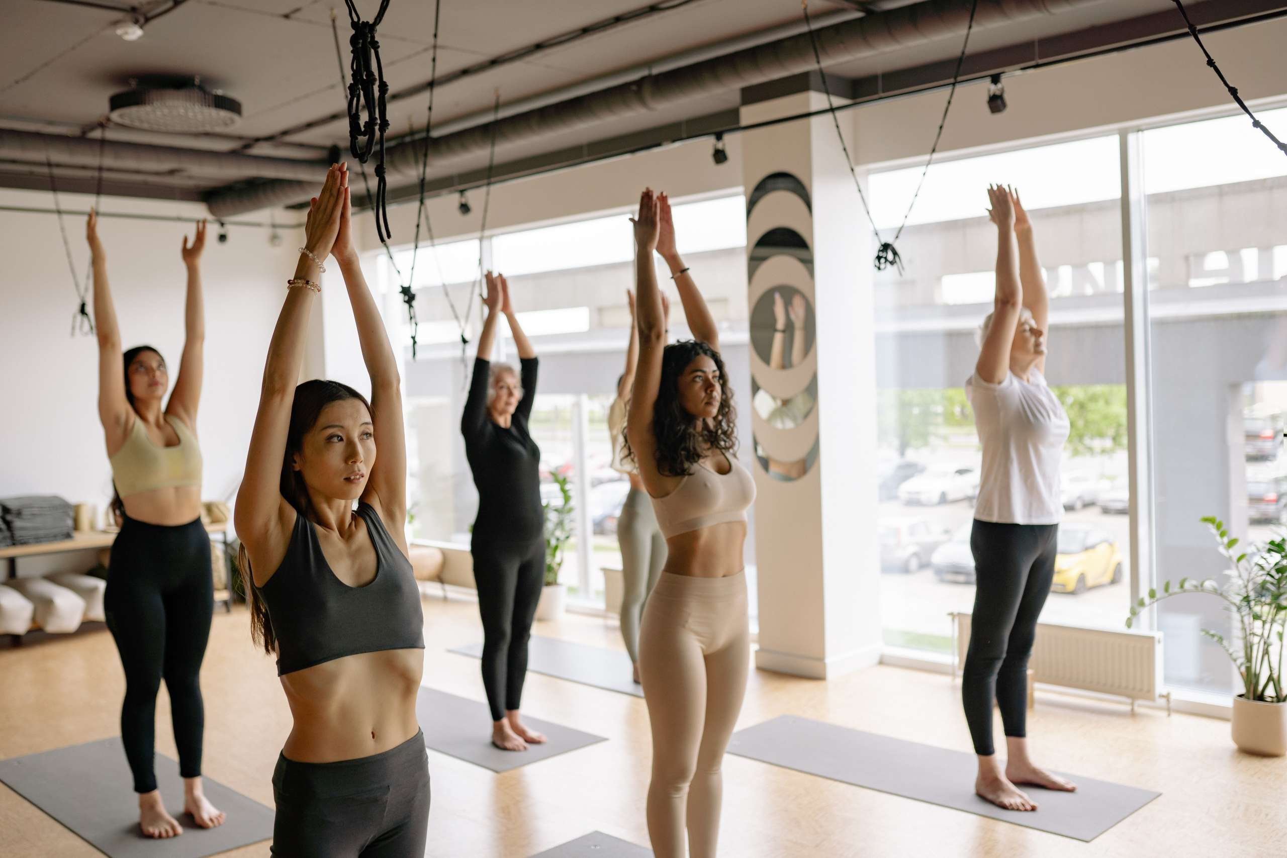 Photo of a yoga class stretching
